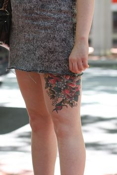 Never really cared for tats on the thigh, but that might be a good place for a giant Tree of Life.  Hm . . .