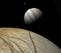 This view is from 990 km above Europa's surface. Visible next to Jupiter are Io and Ganymede. The linear fracture leading to the horizon below Jupiter is at least 1500 km long. Field of view is 34°. The Jupiter map is the same one used in renderings above. The Europa map is from the USGS-Flagstaff web site incorporating some color information from Björn Jónsson's new Europa map. ©2001-2002 Johnston's Archive – Space Art.