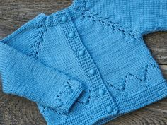 Wonderful raglan sweater for your kids knitted from a wool yarn, soft and warm. Your child in this c Cardigan Bleu, Baby Boy Cardigan, Baby Girl Cardigans, Knit Baby Sweaters, Boys Sweaters, Warm Sweaters, Wool Cardigan, Hooded Sweater, Crochet Girls Dress Pattern