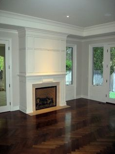 herringbone wood floors; Town and Country fireplace