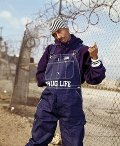 ........... Are those 'thug life' overalls?  Only you, Pac.  Only you.