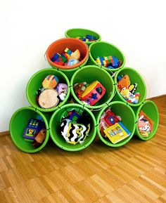 Use 10 Buckets and some cable ties ~ as a toy storage for your children, to separate laundry, a party tool for cold drinks and snacks, put it in your office as a rack for papers, fliers, magazines, etc.