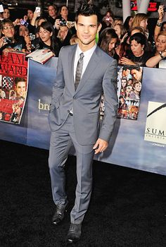 Taylor Lautner looked swoon-worthy in a slim-fitting Z Zegna grey suit.      Read more: http://www.usmagazine.com/entertainment/pictures/inside-the-twilight-saga-breaking-dawn---part-2-premiere-20121211/26046#ixzz2CmexBlin  Follow us: @usweekly on Twitter | usweekly on Facebook