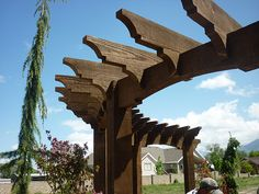 A half circle pergola could add some interest and screening to our back yard.