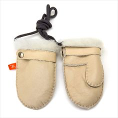 Made from Pure Australian Sheepskin, and an easy to clean slink leather skin to the outside and cozy sheepskin on the inside, these mittens are sure to keep your little ones hands warm. The velcro strap fasteners with a press stud to ensure they stay on. A cord ensures both mittens stay together. Baby Mittens, Leather Skin, Velcro Straps, Hand Warmers, Moccasins, Little Ones, Pure Products, Elks, Winter