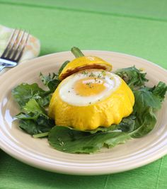 Pattypan Squash with Eggs    (Serves 8 )    8 pattypan squash (about 5 inches across)    About 2 tablespoons olive oil, divided    1 medium onion, finely chopped    1 teaspoon sea salt, divided    3 garlic cloves, minced    1 teaspoon minced thyme    8 large eggs