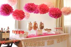 Popcorn, cake pops, and more were displayed under a row of DIY tissue poms.