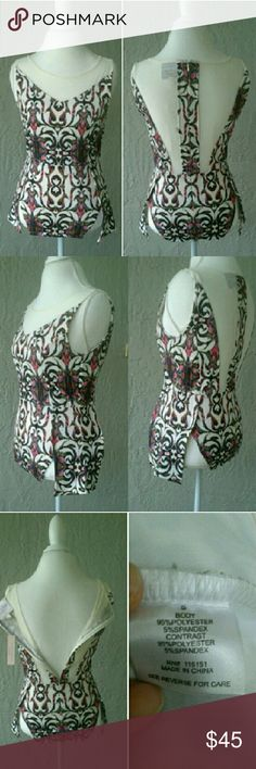 """🌴Sexy chic top🌴 Multicolored top with slits as shown over the hips. Cream color mesh on the neck line and back. Zips up in the back.   Where it under a blazer or embrace the sexy chic style and pair it with a flattering pencil skirt and heels.   Length 26"""" Bust 38""""  I consider reasonable offers. Please see the chart in my closet. Romeo & Juliet Couture Tops Blouses"""