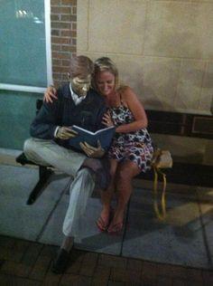 Man reading newspaper statue Indianapolis