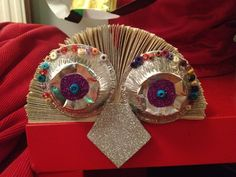 Homemade and recycled Christmas tree decorations - a book folded, mince pie case owl.
