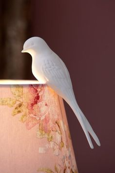 China bird perches on a lamp shade - simple and stunning. Swallow Bird - White