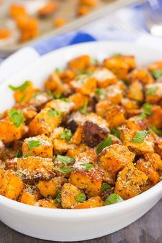 These Roasted Parmesan Herb Sweet Potatoes are seasoned with a blend of Parmesan cheese, garlic, and herbs. Roasted until crispy on the outside and soft on the inside, this easy side dish is full of flavor and perfect for just about any meal!