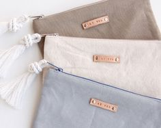Lona color caqui gris cremallera bolsa monograma embrague