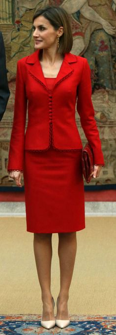 Queen Letizia attended a meeting with representatives Cervantes Institute, at the Royal Palace of El Pardo on October 19, 2015 in Madrid, Spain. For the event, Queen Letizia recycled a Felipe Varela separates outfit that consists of a red jacket with scallop edges and a matching pencil skirt. The skirt suit dates back to 2009 and Letizia has worn it a number of times. She carried a Carolina Herrera 'Maysa' clutch bag, Tous long tear-drop earrings, and Prada nude pointy-toe patent pumps.