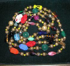 "Vintage Venetian Art Glass Feather Bead Necklace Aventurine Flapper Necklace 58""."