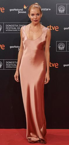 Sienna Miller in a bias-cut copper dress from Galvan