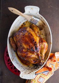 1 3-4 pound roasting chicken  1 small whole lemon  2 tablespoons lemon juice  2 tablespoons maple syrup  1 tablespoon lemon zest  2 teaspoons ground cayenne pepper  1 tablespoon coarse salt