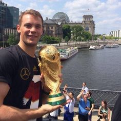 Manuel Neuer holding the World Cup Trophy in Berlin :)