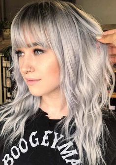 Are you searching for best hairstyles to flaunt with bangs right now? Visit here and get the awesome ideas of silver hair colors and hairstyles with bangs and fringes to flaunt in 2018. The beauty of silver grey color is really stunning for ladies to enhance the looks of their hairstyles.