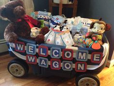 """""""Welcome Wagon"""" - Baby Shower gift filled with misc. baby items (bottles, nipples, pacifiers, onesies, diapers, toys, stuffed animal, booties, mittens, hats, etc)"""