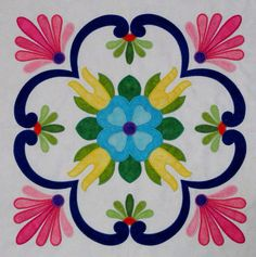 """Fiesta de Talavera -- This breathtaking quilt pattern was inspired by painted Mexican Talavera tiles. Nine 20"""" applique blocks along with an applique border. Finished quilt size is 72"""" x 72,"""" design by J. Michelle Watts."""