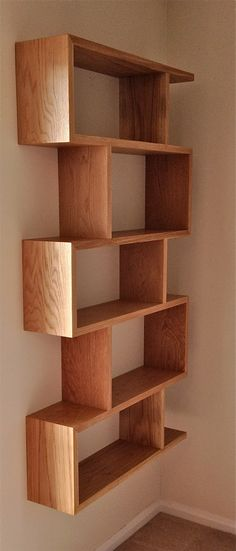 Wall hung Oak shelves by Bridger & Buss