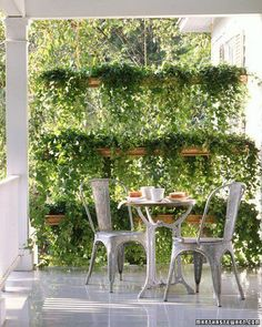 Here They Took Plants, Gutters And Chain To Create A Garden Wall...