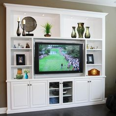 Pacific Coast Custom Design. Entertainment Centers & Built-in Niches. Built-in media niche White paint, display area.