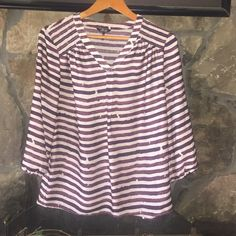 daisy fuentes striped shirtWEEKEND PRICE DROP ONLY A V neck deep burgundy and cream semi sheer striped shirt. Perfect for wearing with jeans and wedges. Daisy Fuentes Tops Tunics