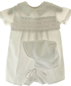Infant boys white baptism Christening romper by Petit Ami features delicate smocking and a Peter Pan collar. Find more baby boys christening outfits in our boutique. Baptism Gown Boy, Baby Boy Christening Outfit, Baby Boy Romper, Christening Gowns, Baptism Party, Baby Boy Outfits, Kids Outfits, Special Occasion Outfits, Romper Outfit