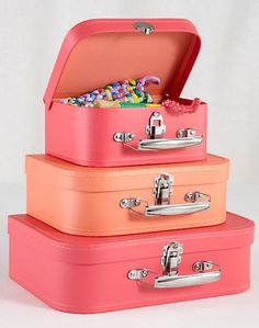 Bon Voyage Suitcases make great room decor for displaying all the trinkets you've collected during your travels around the world. Vintage luggage is especially fun in a travel themed kids room. The bright, vibrant coral color also make these suitcases perfect to use as a gift package.
