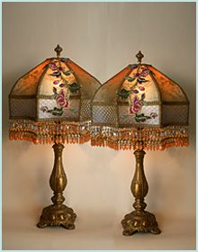 Ornate pair of antique gold candlestick lamps hold a pair of Starfish Peony shades which are dyed dusty indigo to warm amber and covered in a trail of wonderful antique #Chinese gold couched embroidered peony appliqués. Vintage gold net is in the cuff and rare French antique gossamer gold mesh overlays the entire shade. Hand beaded in tones of deep amber, blue, green, and gold.