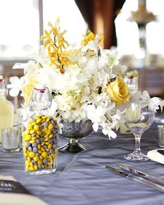 This energetic new Jersey wedding at Bonnet Island Estate includes the perfect use of bright shining color with neutral hues. While slate blue is the new black (at least in the wedding world), Kelly and Dave indulged in one truly special celebration captured by Kay English Photography. We love the multi-colored bridesmaid dresses along with the prettiest yellow florals we've ever seen from MDS Floral design! Take a look at the full event, and check out more wonderful photos below.