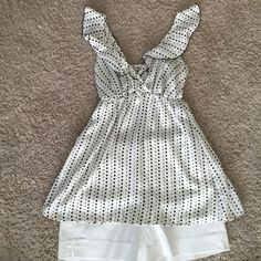 Cute Black and White tank Super cute tank - EUC. Worn handful of times under a suit to work. No signs of wear. Also looks cute with shorts, capris or jeans. Material is 100% polyester. Miuse Tops Tank Tops
