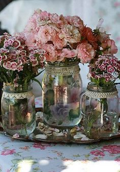 Super inexpensive. Mason jars wrapped in lace on a tray sprinkled with pearls?@lindsay Marie