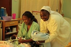 Catholic Sister with a mother and her newborn baby, Nairobi, Kenya