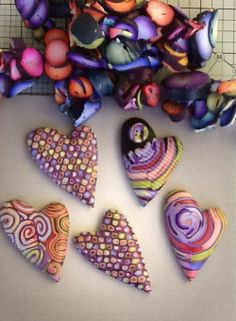 "Ron Lehocky's hearts on Lindly Haunani's Facebook page, ""In the last few years over 50 artists have donated their scrap to Ron Lehocky for his polymer hearts project for the Cerebral Palsy Kids Center. This is a picture of some of his hearts made from my scrap. You can read more about his fundraising project here:"" http://polymerclaydaily.com/2012/10/26/halloween-hearts/"