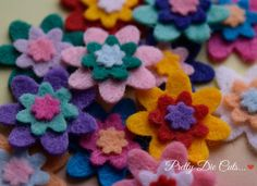 Tiny but oh so cute tripled layered flowers made with 40% premium wool blend felt. Each flower measures 2x2cm (0.78x0.78 inches), packs will be mixed in colours - but as I cut to order, if you have a colour preference then please let me know!  4 different size packs are available, please pick a size when you order... Pack of 10 £1.50 Pack of 20 £2.85 Pack of 40 £5.50 Pack of 100 £13.00  Felt There are three types of felt; Acrylic, Wool Blend and Pure Wool. Acrylic (otherwise known as craft…