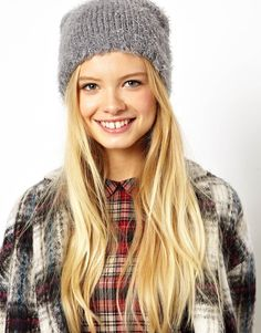 ASOS Fluffy Boyfriend Beanie Hat by ASOS Collection Made from a soft knit fabric. Fluffy, textured finish. Turn-up cuff.