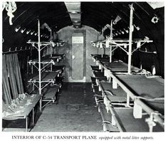 "The interior of a WWII C-54 Skymaster cargo plane, used for trans-oceanic medical air evacuation. In ""A Memory Between Us,"" flight nurse Lt. Ruth Doherty flies in a C-54, but with web strapping litter supports rather than these earlier metal bracket supports."