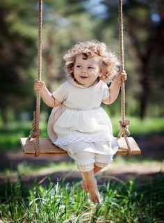 Letting those curls fly in the wind - just swinging without a care!