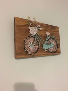 Bicycle String Art With Flowers, Wall Decor, Wood String Art is part of String art diy This bicycle string art is inches and perfect for hanging on wall or leaning on a shelf This bicycle stri - Bicycle String Art, String Art Diy, Bicycle Decor, String Crafts, Bicycle Design, String Art Quotes, Art Corde, Arte Linear, Wood Crafts