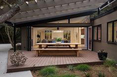 Contemporary Deck with French Beam Teak Dining Bench, Trellis, Fence, exterior stone floors