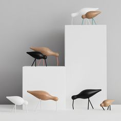 18 Decorative Animal Objects That Blur The Line Between Toys And Decor | Depending on how much color you want in your decor you can either get these birds with colorful or black and white legs and beaks.