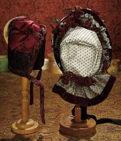 The Memory of All That - Marquis Antique Doll Auction: 58 Patterned Velvet Bonnet with Feathers and Maroon Silk Bows