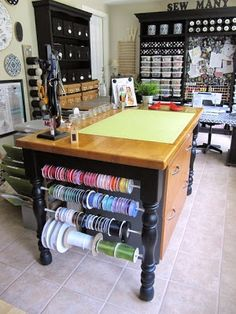 sewing craft room ideas-tension rods between legs for ribbon, paper, or anything on a roll