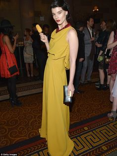 Crystal looked stunning in the faded gold gown as she posed with the star of the film - Magnums Gold ice cream