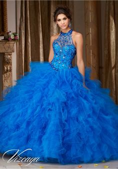 Quinceanera dresses by Vizcaya Jeweled Beading on a Ruffled Tulle Ball Gown Matching Bolero Jacket. Available in Fuchsia, Mint Leaf, Cobalt, White