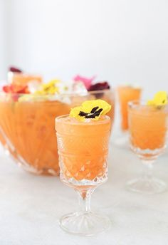 If you like carrots, you will adore this Pineapple and Carrot Gin Punch made with fresh carrot and pineapple juice that's perfect for spring and Easter! Get the recipe on Sugar and Charm!