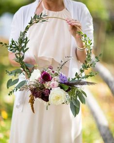 Wedding Flower Swap your bridal bouquet for a floral hoop as a fun, alternative idea for your wedding flowers. - Meet this year's biggest wedding trend. Bridal Musings, Bride Bouquets, Flower Bouquet Wedding, Floral Wedding, Bridesmaid Bouquets, Bridesmaids, Wedding Wreaths, Wedding Decorations, Winter Decorations